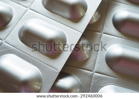 Background made of two silver tablet blister packs