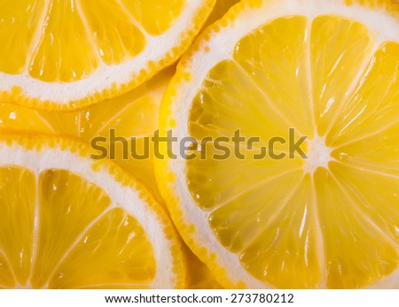 background made with a heap of sliced lemons - stock photo