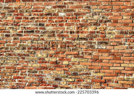 Background made with an old brick wall in hdr tone mapping effect. Vivid colors version. - stock photo