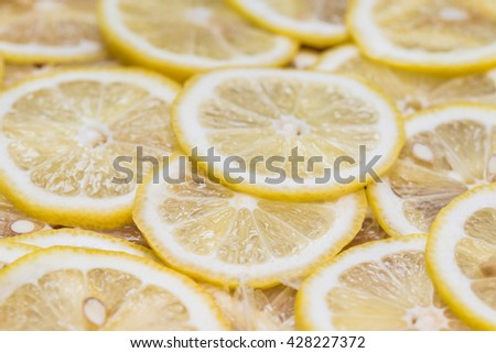 background made with slices of lemon - stock photo