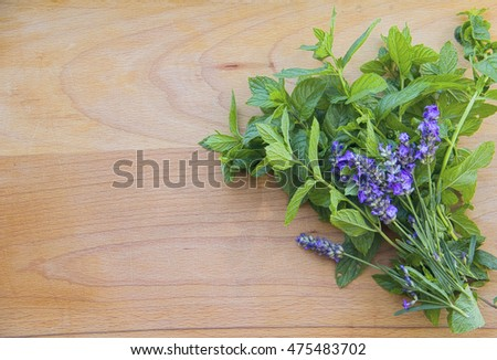Background  mint and lavender on wooden surface