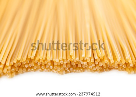 background neatly lined with vertically raw pasta