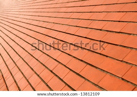 background of a diagonal red orange brick wall - stock photo