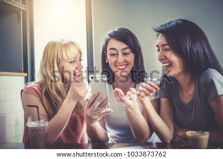 Background of a happy group of friend chatting and talking over lunch in cafe. Beautiful pretty caucasian and asian women sitting together very enjoy selfie and laughing with smile in holidays