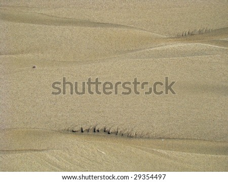 background of a sand surface texture, curves and little stones, wind designed - stock photo