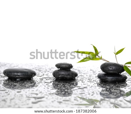 background of a spa with set of stones and green bamboo - stock photo