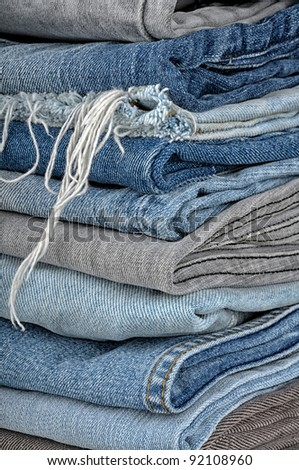 background of a stack of old jeans - stock photo