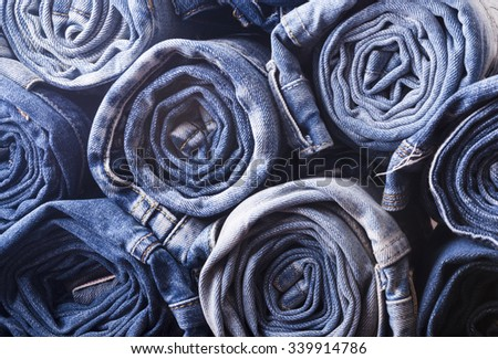 background of a stack rolled jeans - stock photo