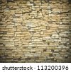 Background of an old grunge brick wall illuminated texture - stock photo