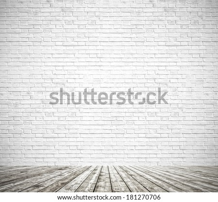 Background of an old natural wooden darken brown floor with messy and grungy textured white brick and stone wall inside vintage neglected and deserted warm light interior, carpentry brickwork concept - stock photo