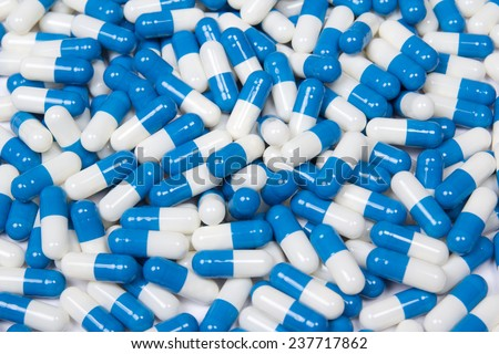 background of blue and white capsule pills - stock photo