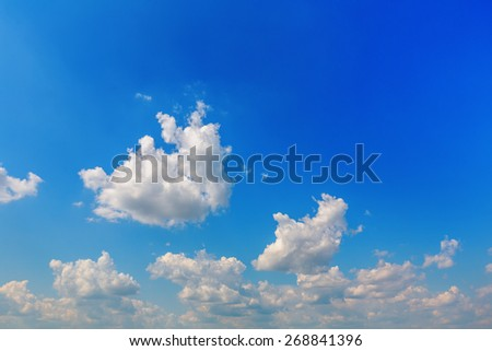Background of blue sky with cumulus clouds - stock photo