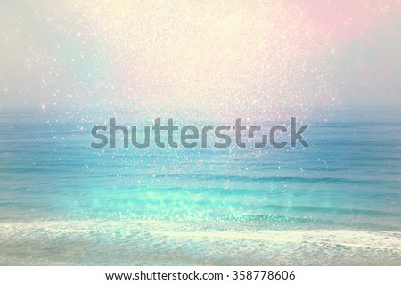 background of blurred beach and sea waves with bokeh lights, vintage filter.  - stock photo