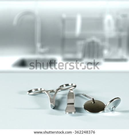 background of blurred hospital interior with silver tools on blue space