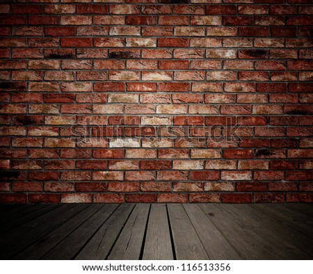 Background of brick wall and wooden planks in old interior - stock photo