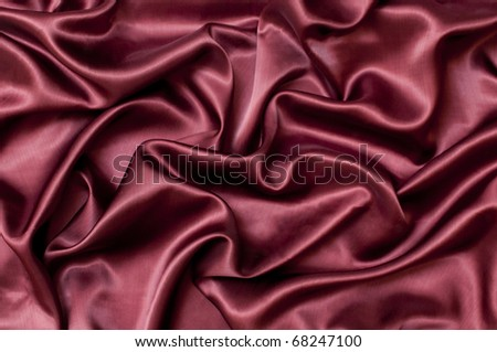 background of bright ruby satin with waves - stock photo