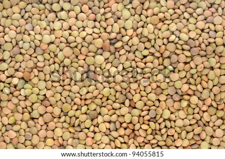 background of brown small dry raw lentils - stock photo