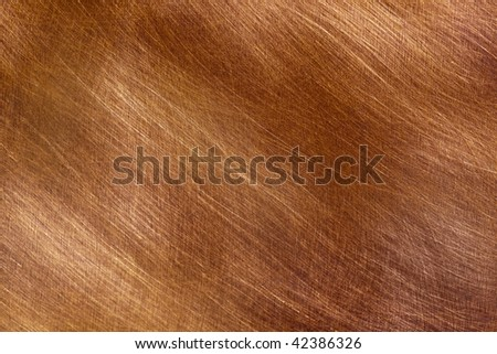 Background of brushed copper, in full-frame.  Lovely textures and detail. - stock photo