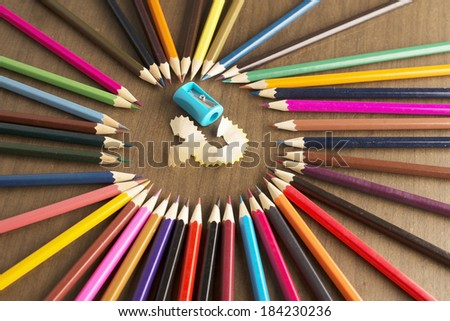 background of bunch of colored pencils on shavings idea of concentration and attraction to nucleus center circle radius unity concept of leadership, community, the team focused on one goal - stock photo