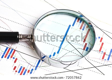 Background of business graph and a magnifier - stock photo