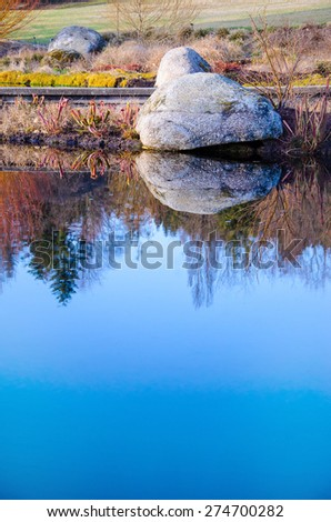 Background of calm water and stone in the evening - stock photo