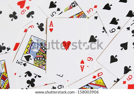 background of cards with heart of ace on the top - stock photo