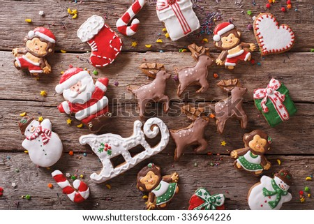Background of Christmas gingerbread in the form of toys on a wooden table close-up. horizontal view from above - stock photo