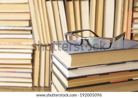 Background of Closed and Opened stack books lying on the bookshelf backdrop Idea of education, library in school and university - stock photo