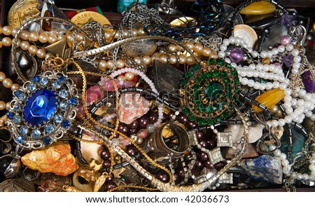 Background of closeup of Treasure chest  with bijouterie - stock photo