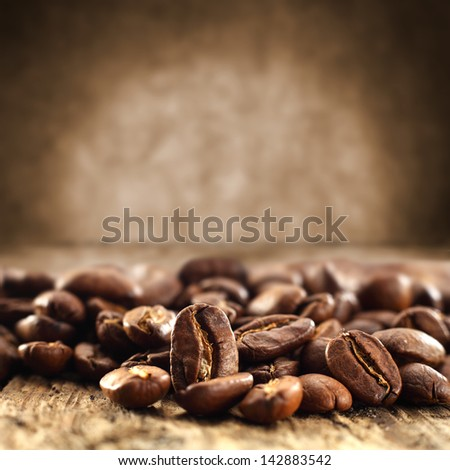background of coffee beans and brown dirty wall - stock photo