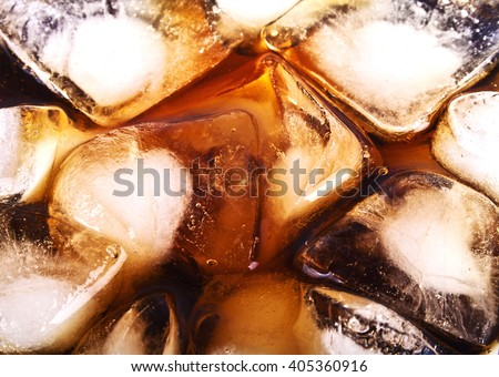 Background of cola with ice cubes and bubbles - stock photo