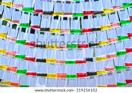 Background of color water in the translucent plastic bag - stock photo