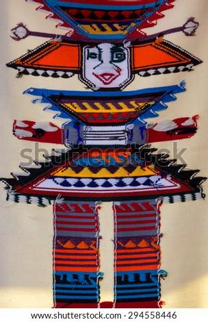 Background of colored Ecuadorian textile at the market of Otavalo in Ecuador, 2015. - stock photo