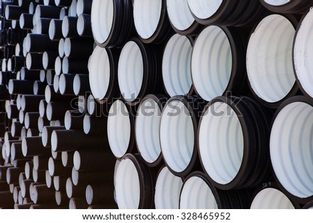 background of colorful big plastic pipes used at the building site. - stock photo