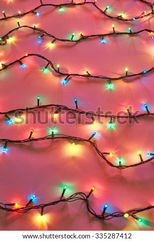 Background of colorful Christmas lights. Decorative garland