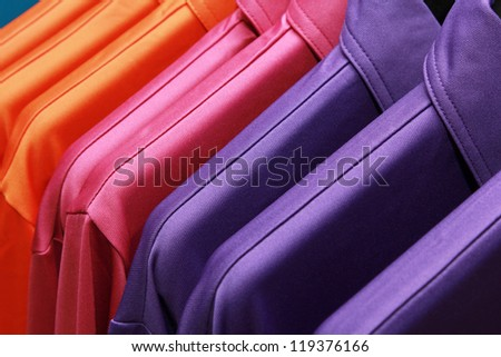 background of colorful clothes on a hanger - stock photo