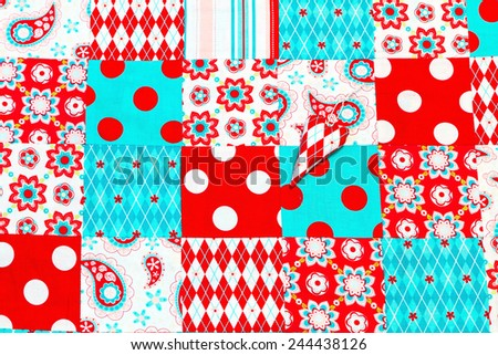 Background of colorful patchwork fabrics and heart - stock photo
