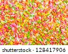 Background of colorful sprinkles, jimmies for cake decoration or ice cream topping - stock photo