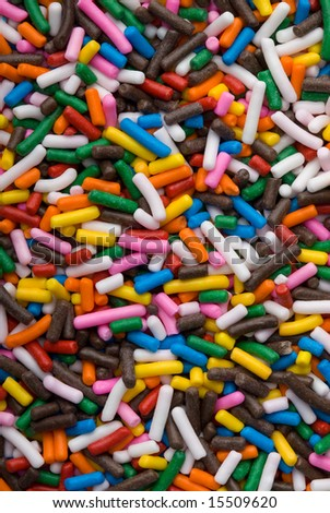 Background of colorful sprinkles, jimmies for cake decoration or icecream topping - stock photo
