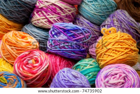 Background of colorful wool skeins - stock photo