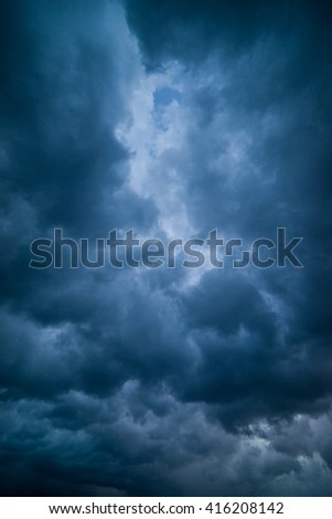 Background of dark and dramatic  clouds before a thunder-storm - stock photo