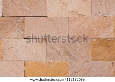 Background of decorate sand stone wall surface - stock photo