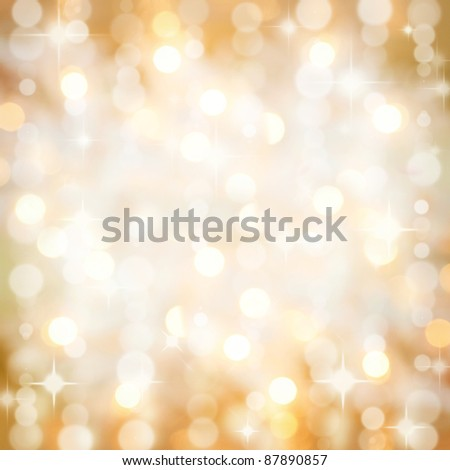 Background of defocussed golden lights with sparkles. Christmas, New Years, disco party. - stock photo