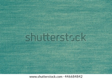 Background of denim material. The texture of blue jeans trousers.
