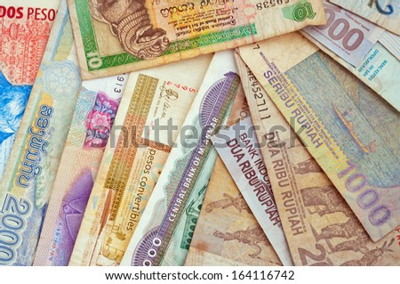 Background of different currencies - stock photo