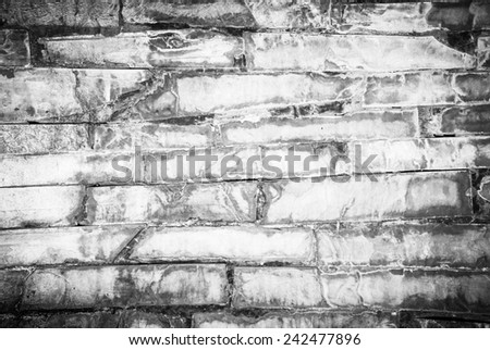 Background of dirty stone wall made with blocks, High contrast, infrared effect - stock photo