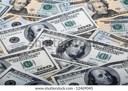 Background of $100 dollar bills and $20 dollar bills - stock photo