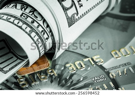 Background of dollars and bank cards tinted green