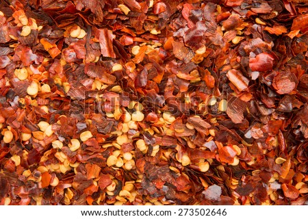 Background of dried chilly pepper flakes - stock photo