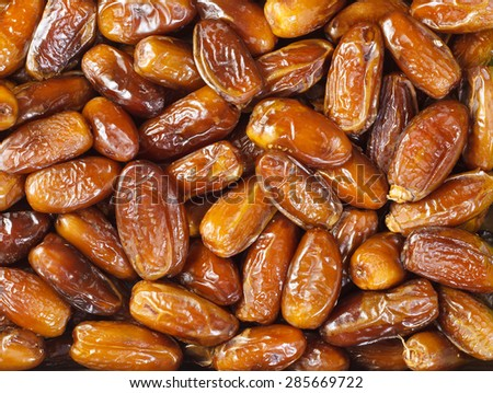 Background of dried dates fruit, at the open air market - stock photo